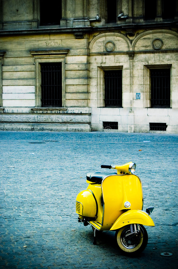 Free Yellow Scooter In Plaza Stock Image - 1852841