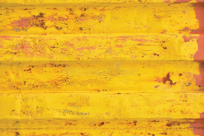 Yellow sea freight container background, rusty corrugated pattern, red primer coating, horizontal rusted detailed steel texture royalty free stock photos