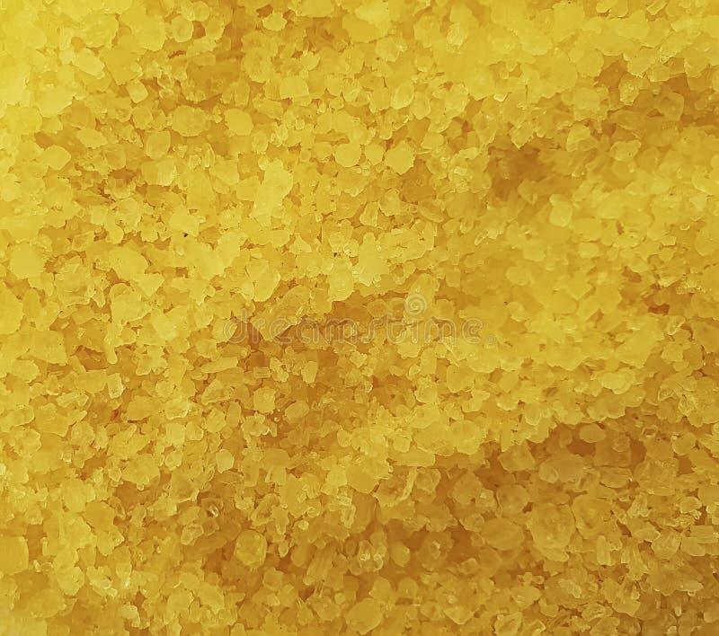 Yellow sea salt closeup organic background cosmetic crystal. Yellow sea salt , closeup background cosmetic organic  crystal royalty free stock photography