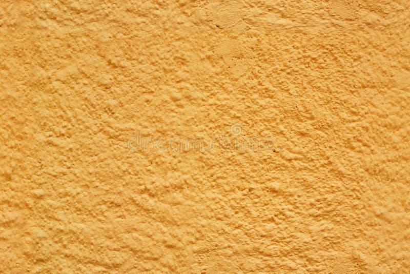 Yellow seamless stucco texture stock image