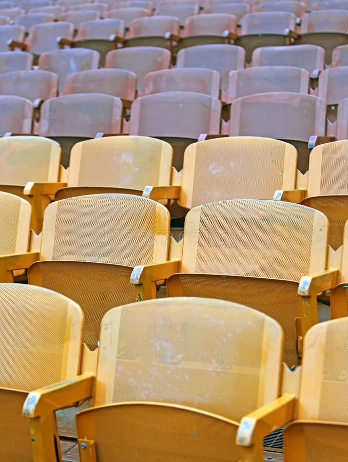Yellow seats before the sporting event. Many empty seats in the stands before the sporting event royalty free stock photos