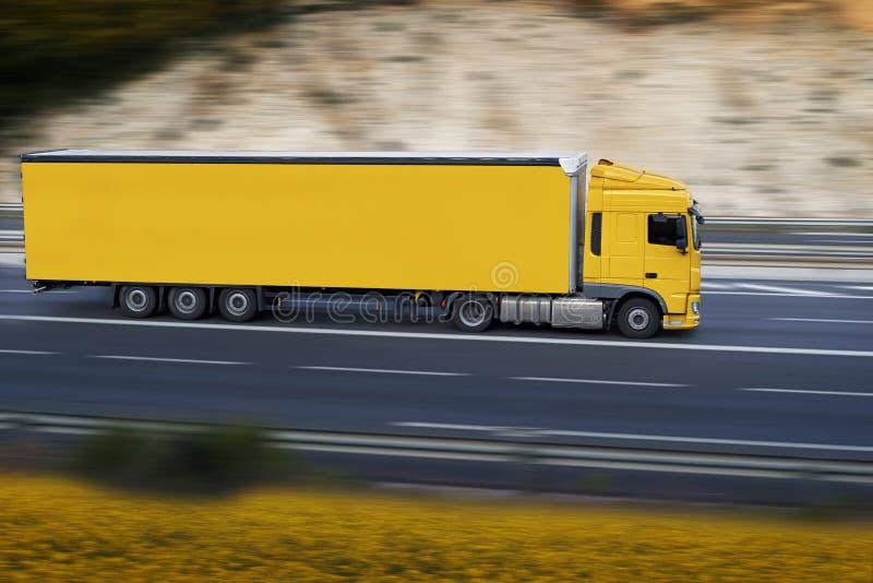 Yellow semi truck stock photo