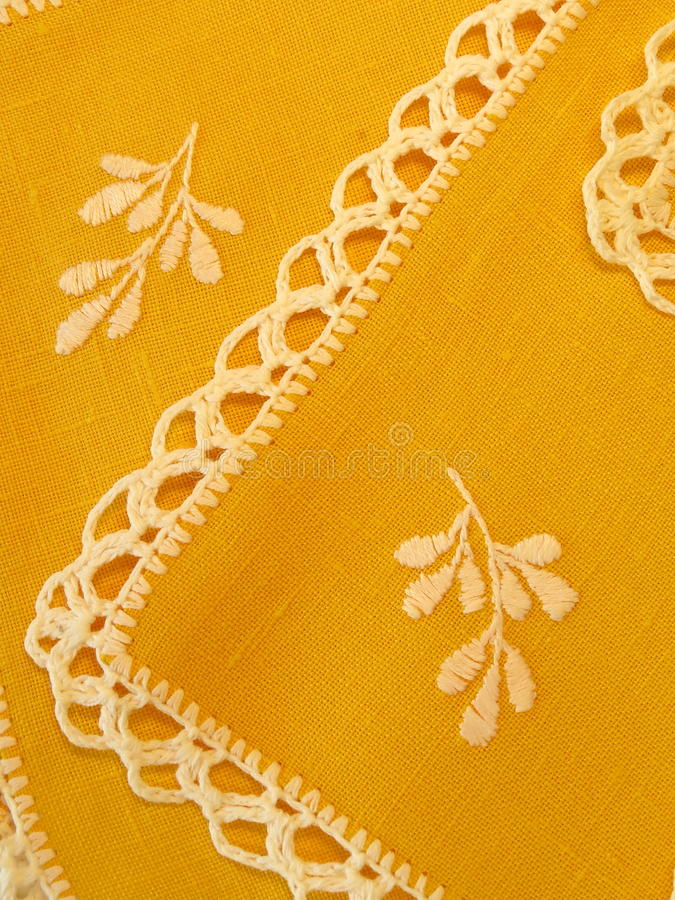 Yellow serviette. With floral needlework and crochet stock images