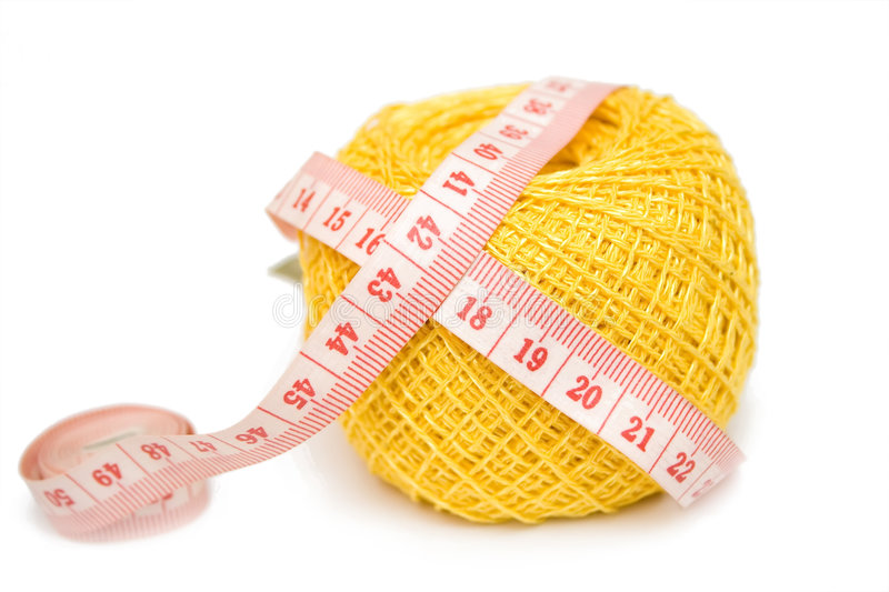 Yellow Sewing Clew And Centimeter Stock Photos