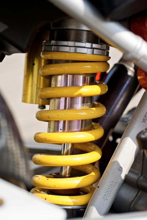 Yellow shock absorber. From racing motor stock photography