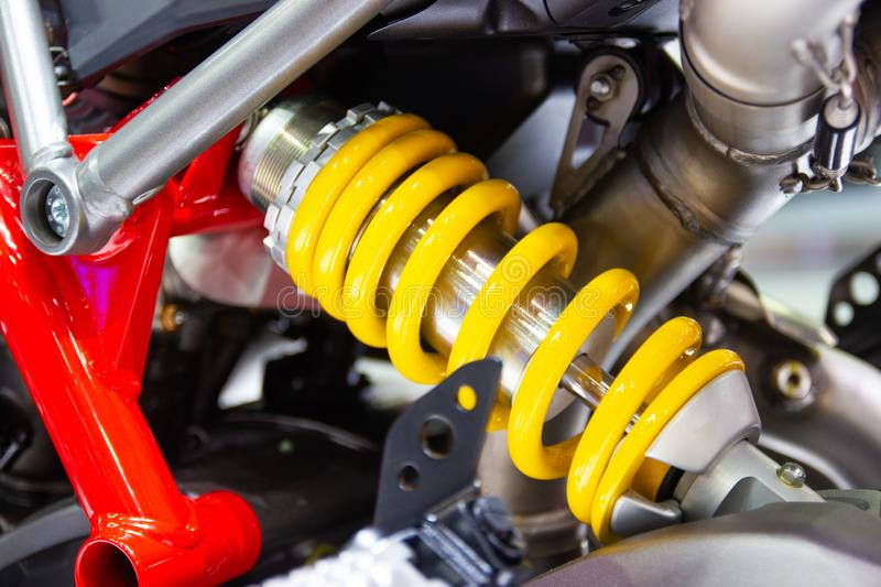 Yellow Shock Absorbers of Motorcycle for absorbing jolts royalty free stock image