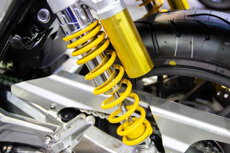 Yellow Shock Absorbers of Motorcycle for absorbing jolts royalty free stock photo