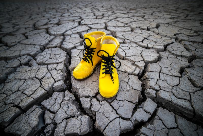 Yellow shoes on the rock. Tourism stock photography
