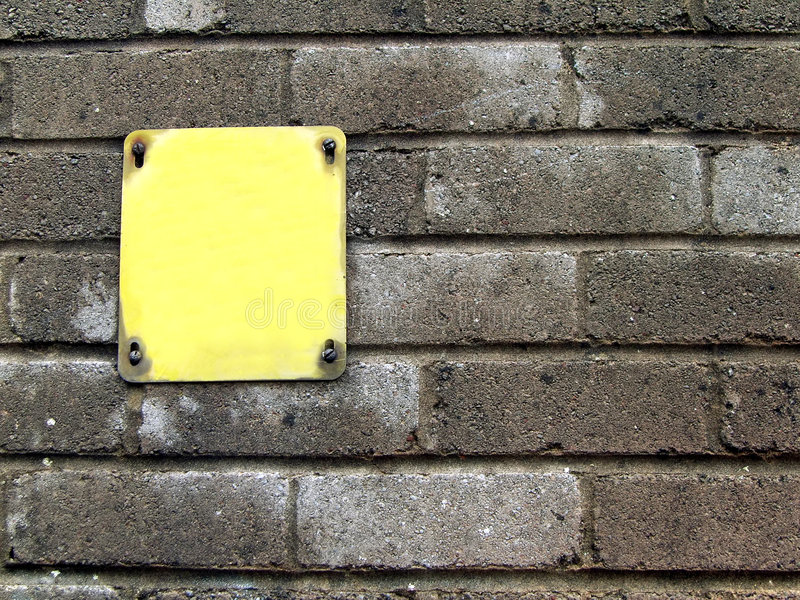 Download Yellow Sign On Concrete Wall Stock Image - Image: 517641