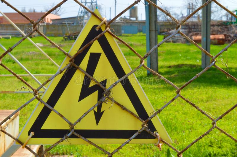 Yellow sign of electric shock stock images