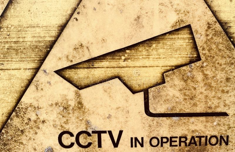 Weathered CCTV in operation sign stock photo