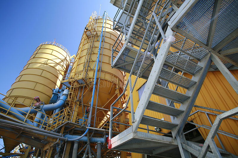 Yellow silos industrial plant royalty free stock photo