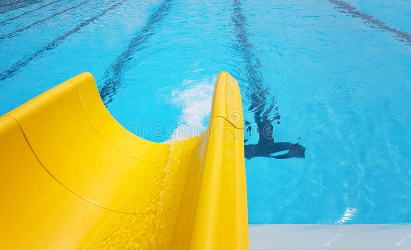 Yellow slide pool. Detail of yellow slide chute in the pool royalty free stock photography
