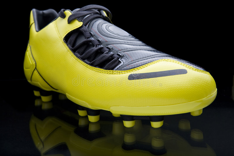 Yellow soccer footwear royalty free stock photography