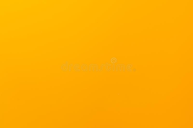 Yellow solid color background with matte texture. Wallpaper design. Yellow matte surface, abstract, bright, light, material, orange, colorful, art, bumpy royalty free stock photo
