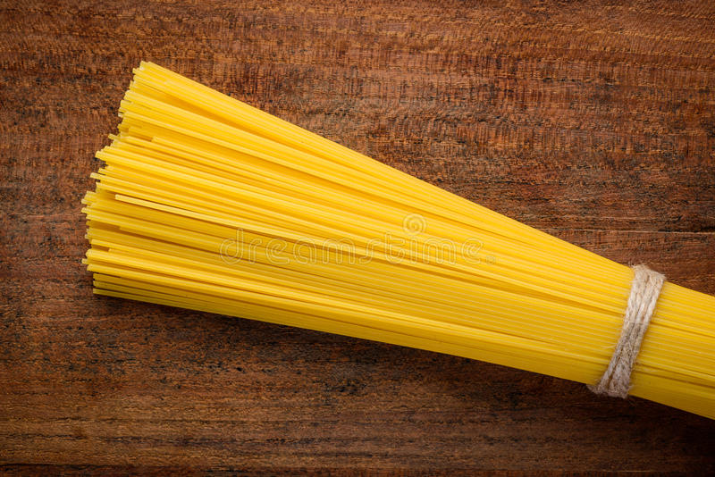 Yellow Spaghetti Bundle Pasta stock photos