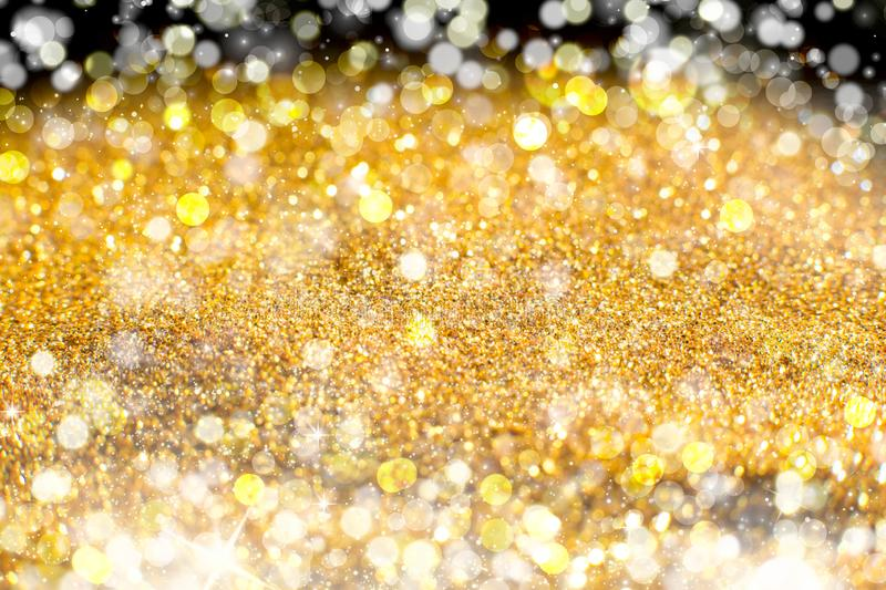 Yellow Sparkling Lights Festive background with texture. Abstract Christmas twinkled bright bokeh defocused and Falling stars royalty free stock image