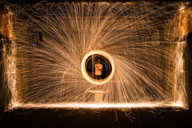 Yellow Sparks in Front of Person in White Top stock image