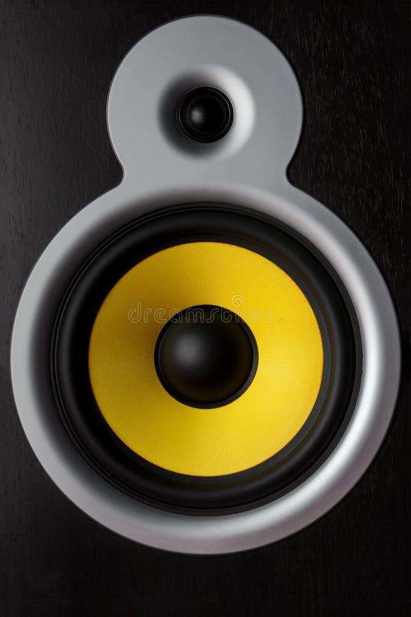 Yellow speaker loudspeaker close-up part of a musical column stock photos
