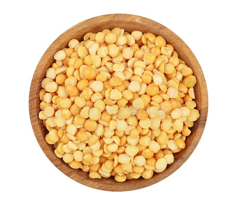 Yellow split peas in a wooden bowl isolated on white background. Top view stock images
