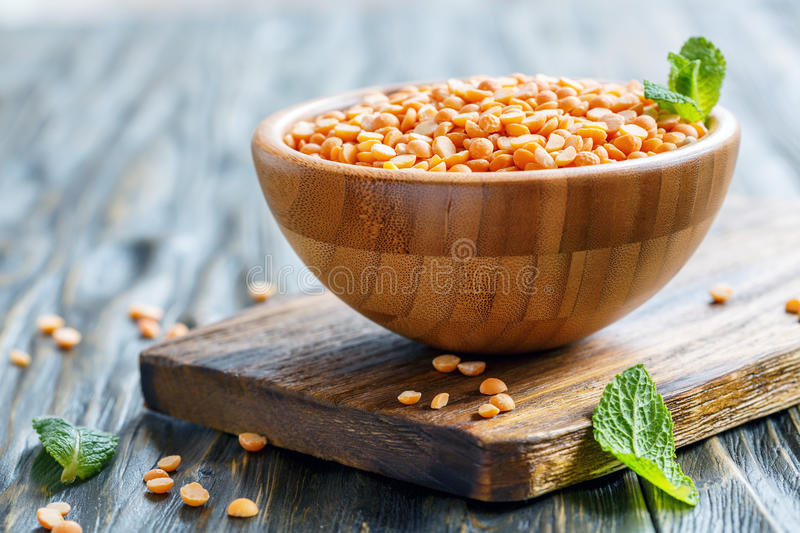 Yellow split peas in a wooden bowl. stock photography