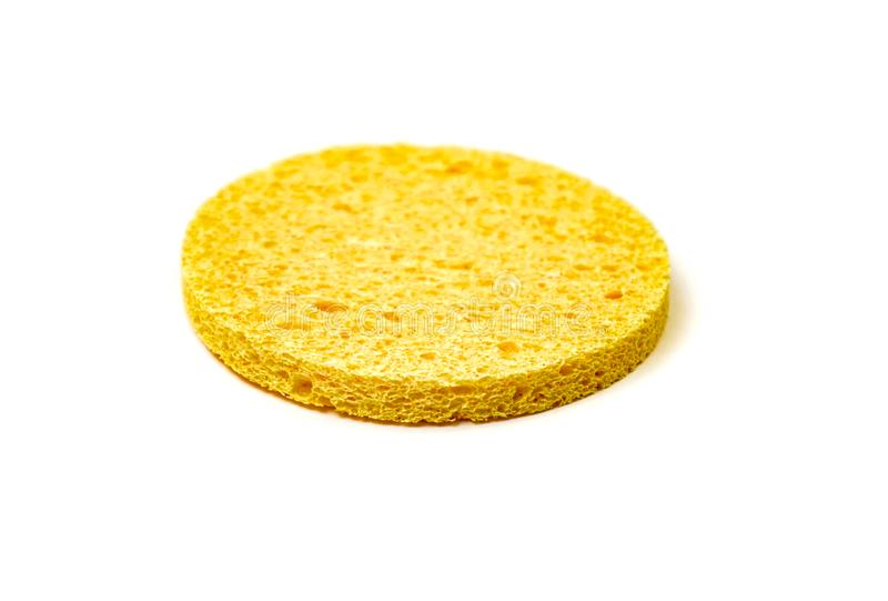 yellow sponge for face isolated on white background royalty free stock photo