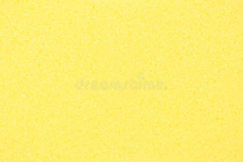 Yellow sponge texture. Abstract background image of bath sponge royalty free stock photography