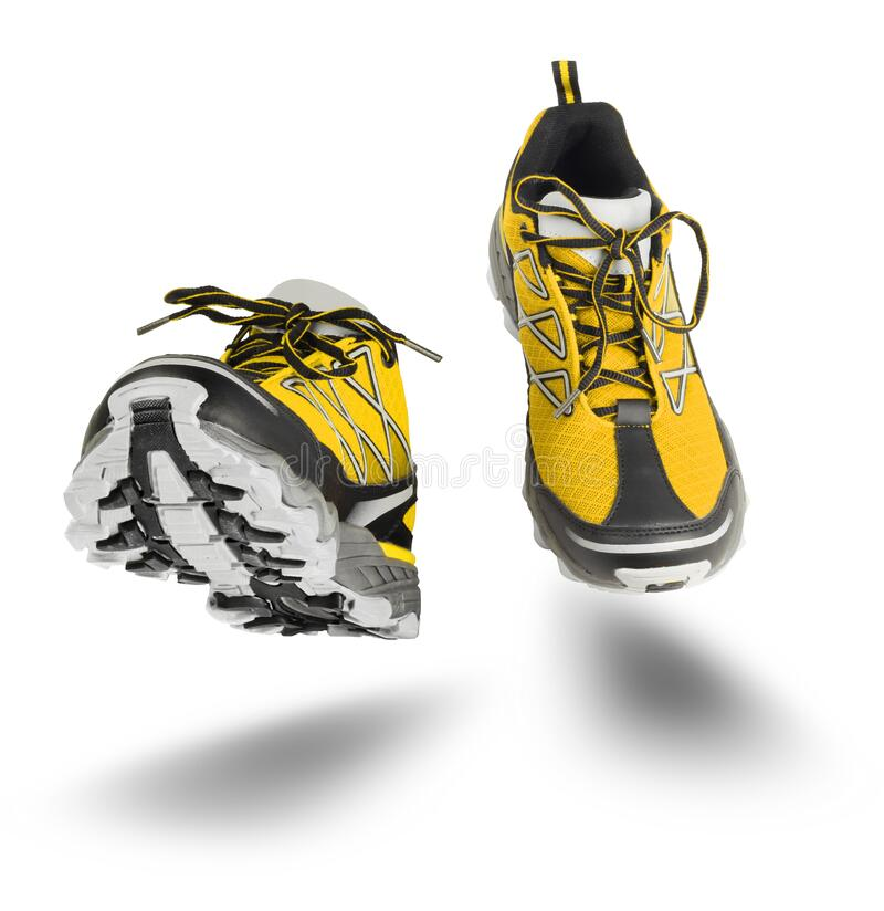 Yellow sport shoes running isolated on white stock photo
