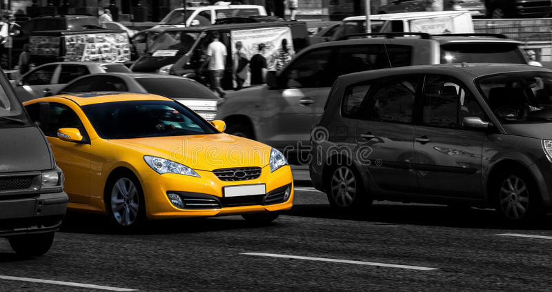 Yellow sports car in the city royalty free stock image