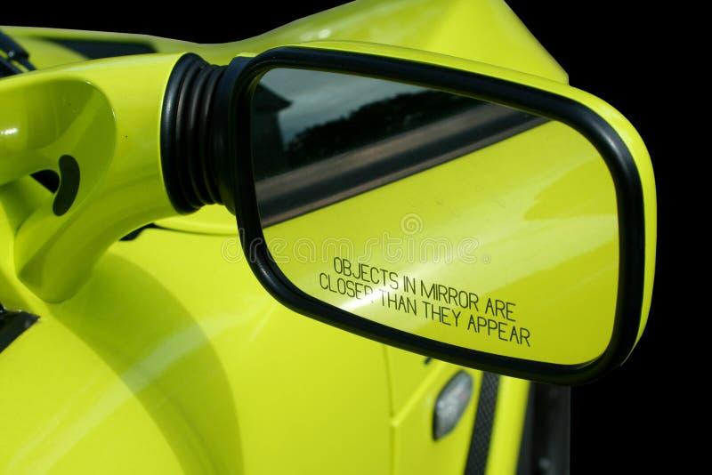 Yellow sports car mirror stock image