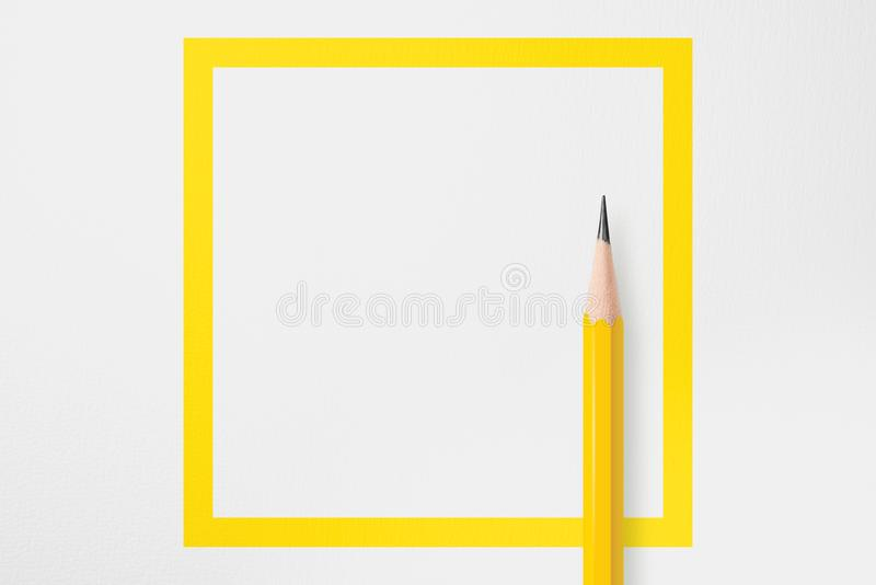 Yellow square line with yellow pencil royalty free stock photo