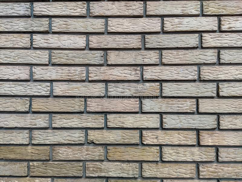 Yellow standard bricks found on building walls with even pattern and rough texture, cool wallpaper or background of a wall. Yellow standard bricks found on stock image