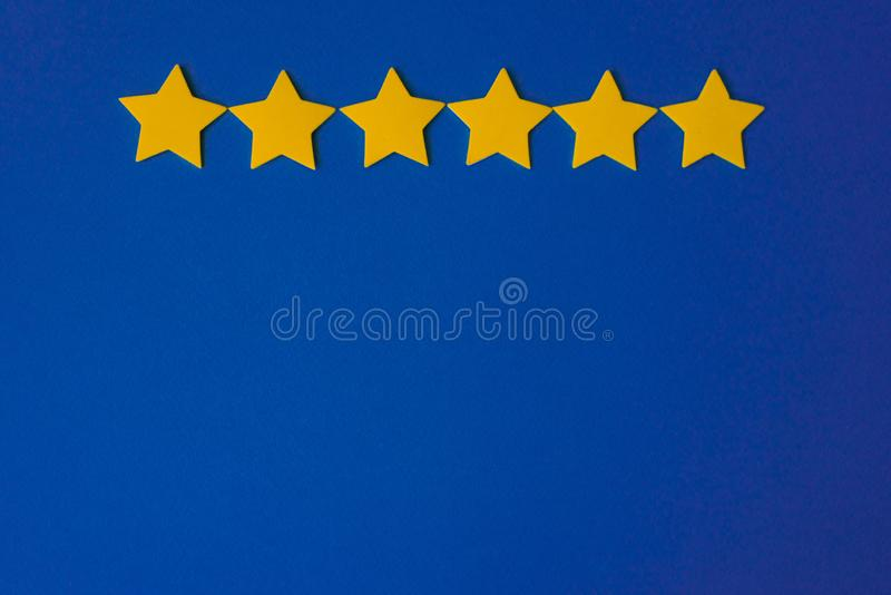 Yellow stars against the blue night sky. Application paper on the right. Weather forecast concept. Yellow stars against the blue night sky. Application paper on stock image