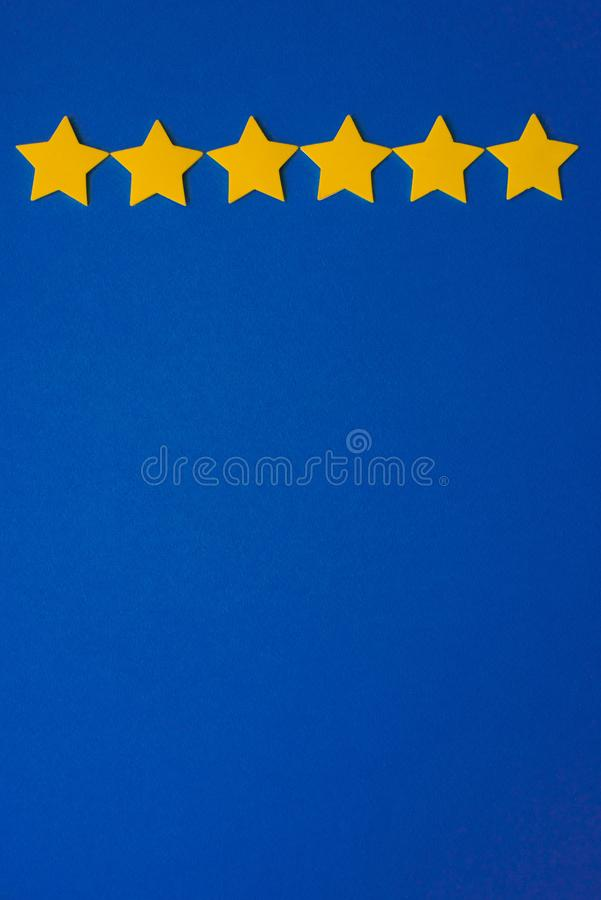 Yellow stars against the blue night sky. Application paper on the right. Copy space. Weather forecast. Concept stock photography