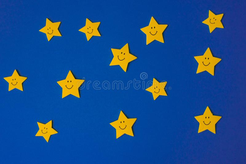 Yellow stars against the blue night sky. Application paper on the right. Copy space. stock photo