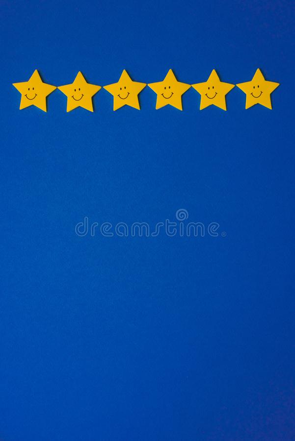 Yellow stars against the blue night sky. Application paper on the right. Copy space. Weather forecast concept royalty free stock images