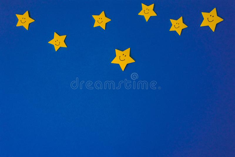 Yellow stars against the blue night sky. Application paper on the right. Weather forecast concept. Yellow stars against the blue night sky. Application paper on royalty free stock photo