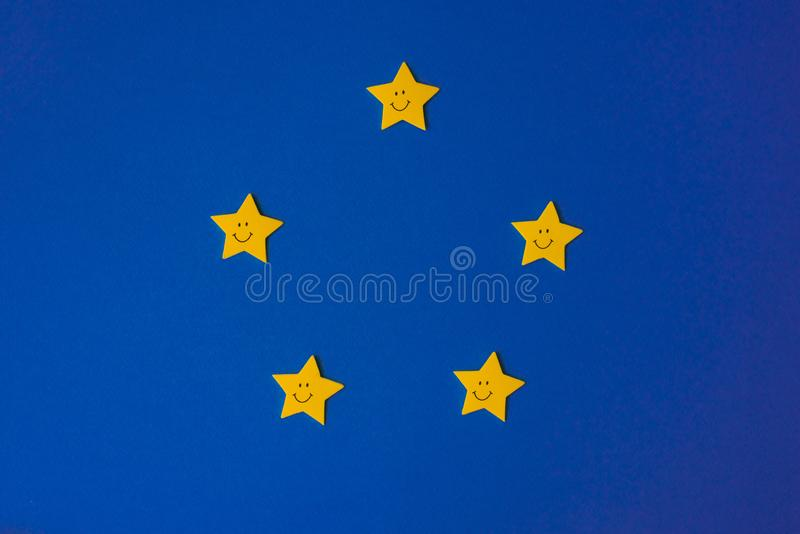 Yellow stars against the blue night sky. Application paper on the right. Weather forecast concept. Yellow stars against the blue night sky. Application paper on royalty free stock photos