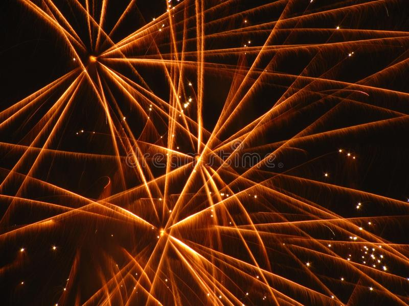 Yellow stars of fireworks royalty free stock images