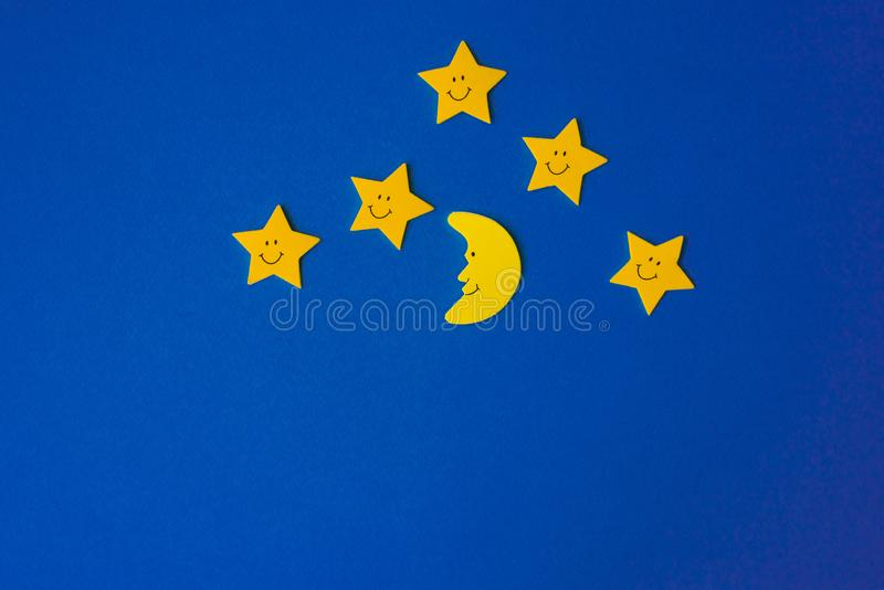 Yellow stars and the moon against the blue night sky. Application paper on the right. Weather forecast concept. Yellow stars and the moon against the blue night stock image