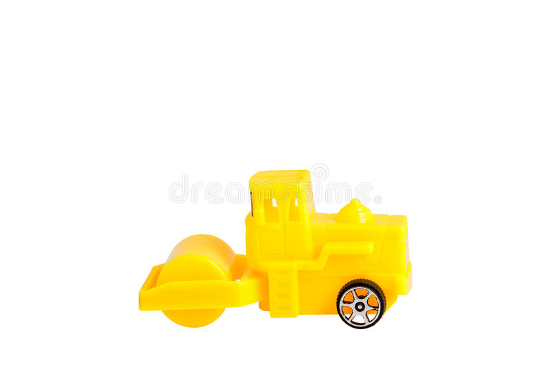 Yellow steamroller toy isolated on white background. stock photography