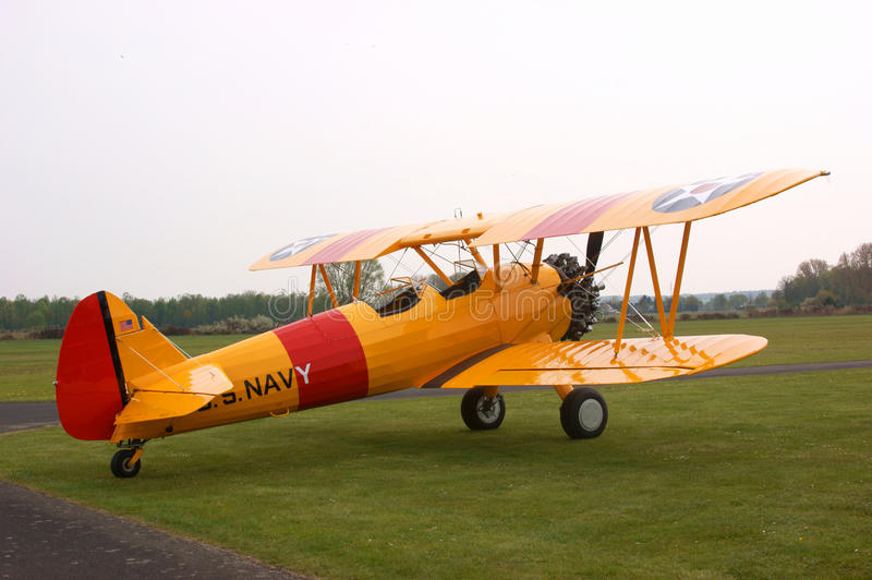 Yellow stearman biplane. Historic yellow stearman biplane with US NAVY marking (this is an original historic collor coding stock photo