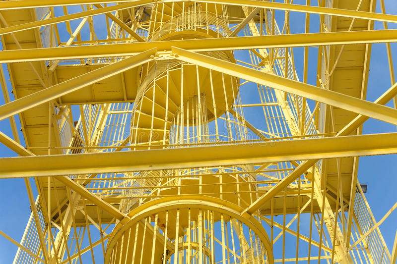 Yellow steel structure. Industrial construction - Yellow metal structure with vivid blue sky background royalty free stock photo