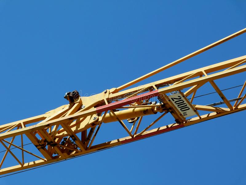 Yellow steel truss crane boom detail under blue sky. Yellow color painted steel truss crane boom detail under blue sky. building industry concept. construction royalty free stock images