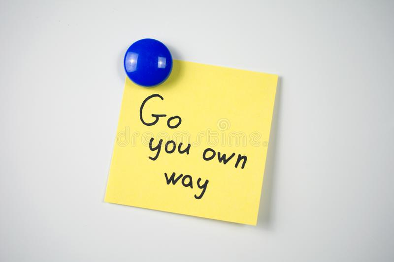 Yellow sticker Go your own way stock photography