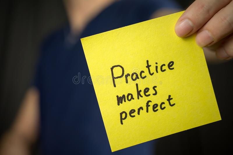 Yellow sticker inscription Practice makes perfect royalty free stock image