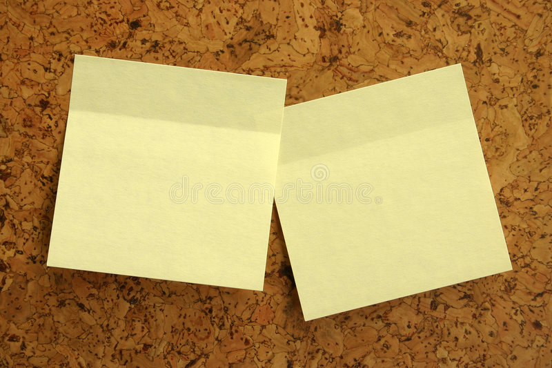 Yellow stickers. On cork board for announcements royalty free stock image