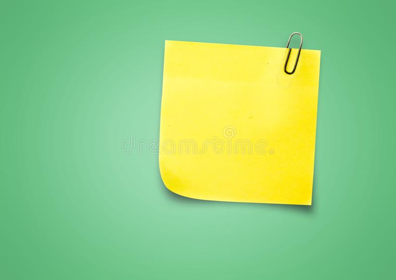 Yellow Sticky Note against a neutral green background. Digital composite of Yellow Sticky Note against a neutral green background stock image