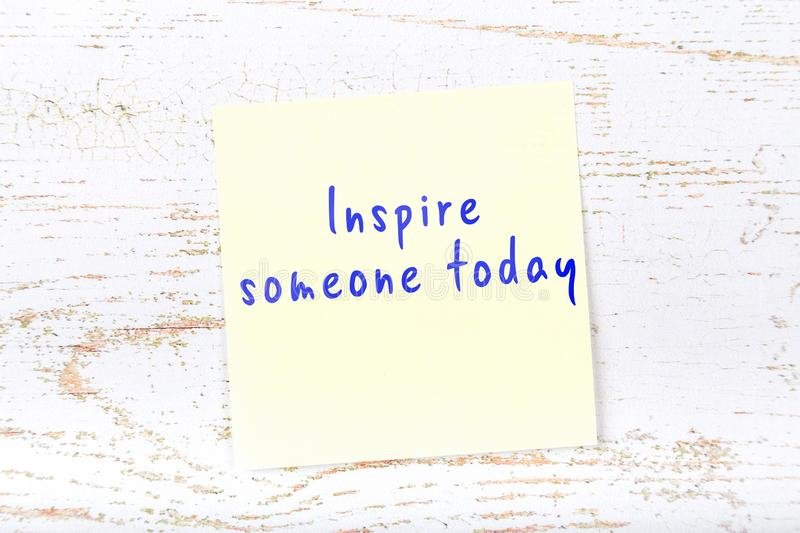 Yellow sticky note with handwritten text inspire someone today royalty free illustration