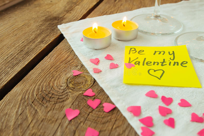Yellow sticky note for Saint Valentine's day and little pink pap royalty free stock photo
